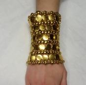Широкий браслет от Philippe Audibert (Paris), металл, цвет - золотой.