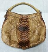 Сумка из кожи питона от итальянского бренда Silvano Biagini.