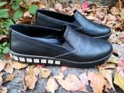 Шикарные слипоны Prada ( Прада ), оригинал, кожаные, цвет - черный.